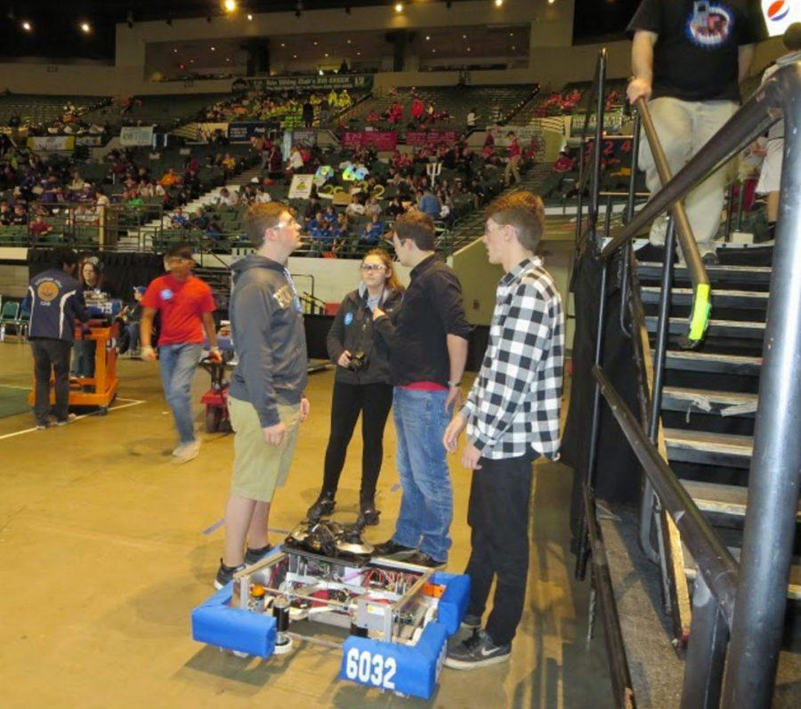 Senior Robotics team members Alexander Burchett, Jake Shockley, John Woodman, and Junior Sydney Green alongside #6032 at the FIRST Robotics Buckeye Regional competition. West Carrollton's team was awarded the Rookie All-Star award, and competing in the WORLD's competition later this month.