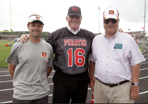 Dr. Clifford with his grandson Paul (right) and Mike Brown (left), the manager of the Cincinnati Bengals at the Bengals practice held here at WCHS.