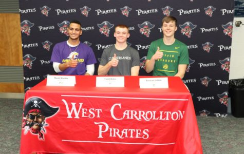 Seniors Noah Martin, Todd Bales and Tristan Dillon signing to play their sport in college